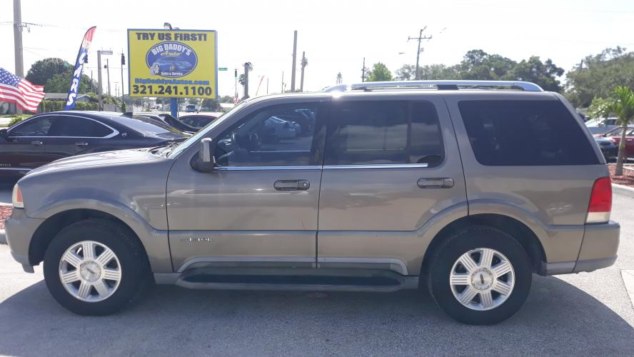 2004 Gold Lincoln Aviator 2WD Luxury (5LMEU68H24Z) with an 4.6L V8 DOHC 32V engine, 5-Speed Automatic Overdrive transmission, located at 1181 Aurora Rd, Melbourne, FL, 32935, (321) 241-1100, 28.132914, -80.639175 - Photo #0