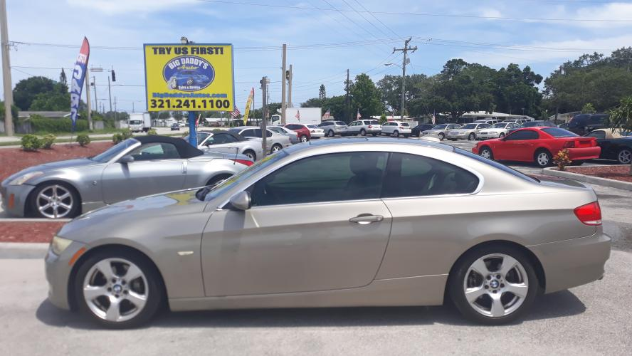 2009 Gold BMW 3-Series 328i Coupe (WBAWB33599P) with an 3.0L L6 DOHC 24V engine, Automatic transmission, located at 1181 Aurora Rd, Melbourne, FL, 32935, (321) 241-1100, 28.132914, -80.639175 - Photo #0
