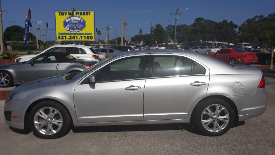 2012 Silver Ford Fusion SE (3FAHP0HA3CR) with an 2.5L L4 DOHC 16V engine, Automatic transmission, located at 1181 Aurora Rd, Melbourne, FL, 32935, (321) 241-1100, 28.132914, -80.639175 - Photo #0