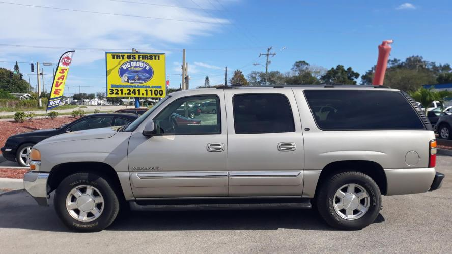 2004 Gold GMC Yukon XL 1500 4WD (3GKFK16Z54G) with an 5.3L V8 OHV 16V FFV engine, Automatic Overdrive transmission, located at 1181 Aurora Rd, Melbourne, FL, 32935, (321) 241-1100, 28.132914, -80.639175 - Photo #0