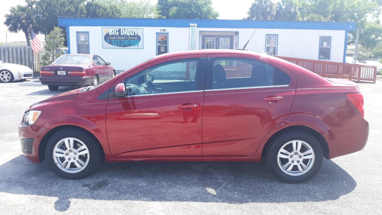 2012 RED Chevrolet Sonic 2LT Sedan (1G1JC5SH5C4) with an 1.8L L4 DOHC 24V FFV engine, Automatic transmission, located at 1181 Aurora Rd, Melbourne, FL, 32935, (321) 241-1100, 28.132914, -80.639175 - Photo #0