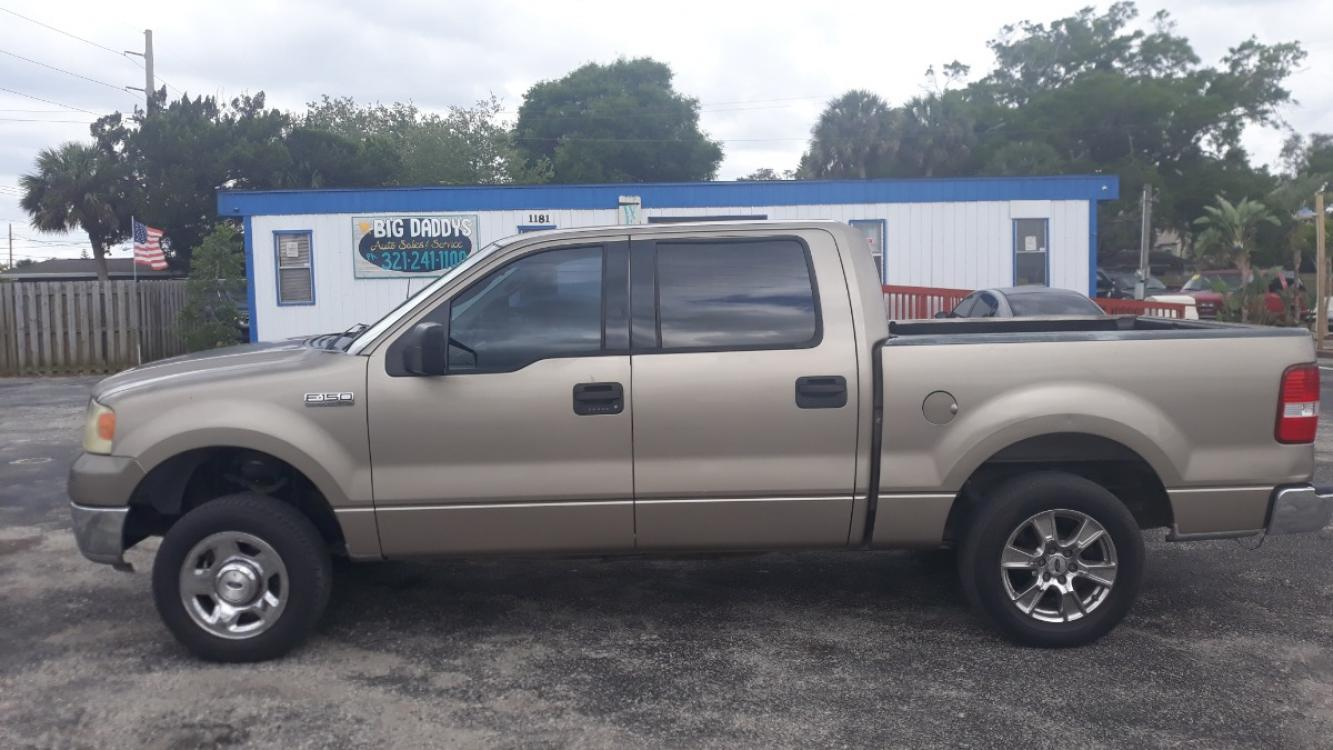 2004 Gold Ford F-150 Lariat SuperCrew 2WD (1FTPW12584K) with an 5.4L V6 SOHC 16V engine, Automatic Overdrive transmission, located at 1181 Aurora Rd, Melbourne, FL, 32935, (321) 241-1100, 28.132914, -80.639175 - Photo #0