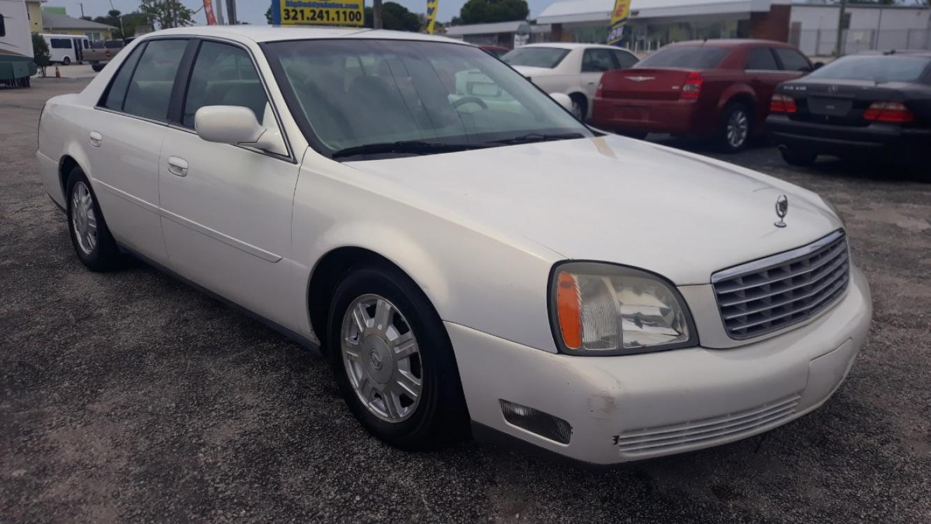 2004 White Cadillac Deville Sedan (1G6KD54Y64U) with an 4.6L V8 DOHC 32V engine, Automatic Overdrive transmission, located at 1181 Aurora Rd, Melbourne, FL, 32935, (321) 241-1100, 28.132914, -80.639175 - Photo #1
