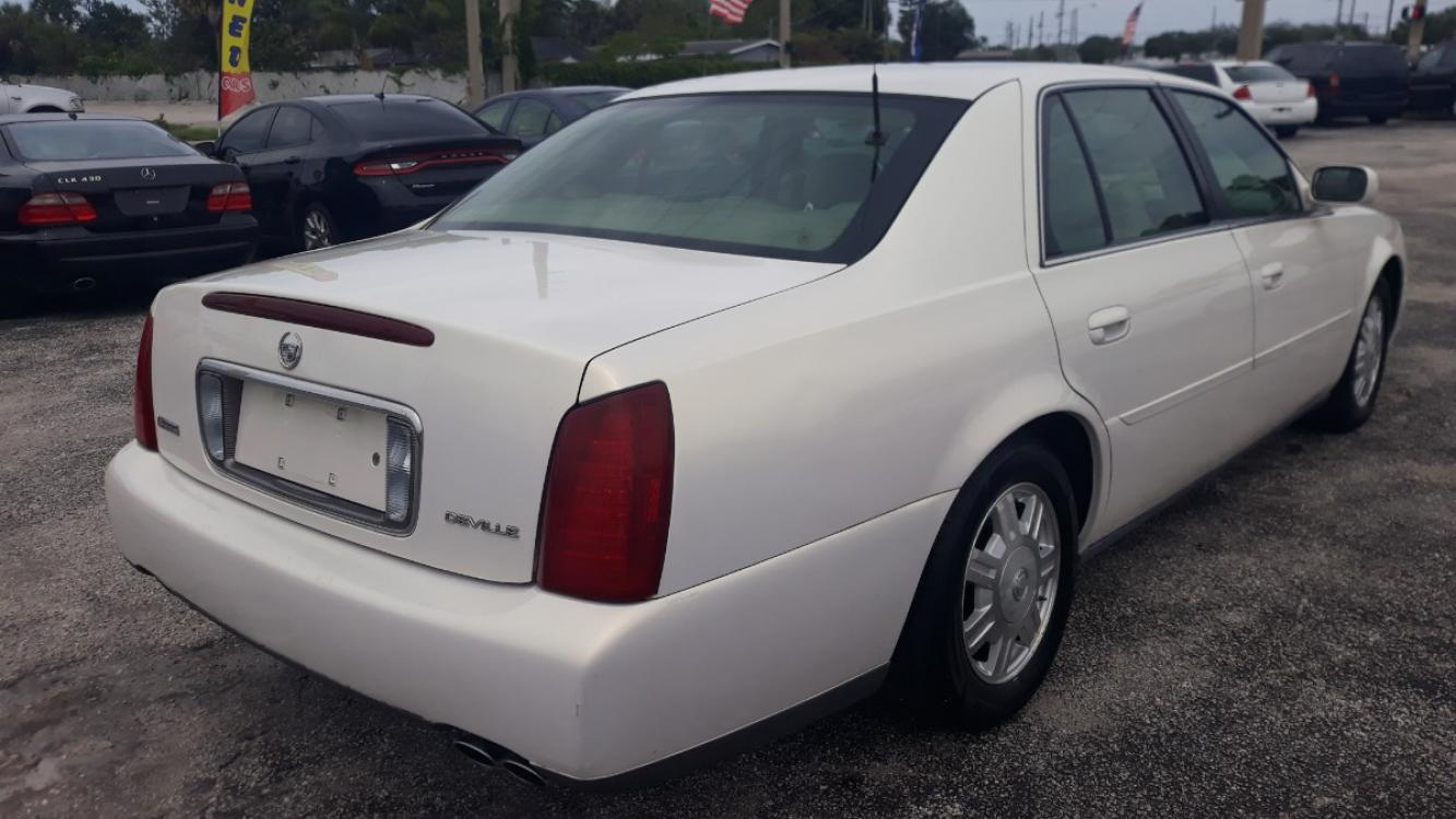 2004 White Cadillac Deville Sedan (1G6KD54Y64U) with an 4.6L V8 DOHC 32V engine, Automatic Overdrive transmission, located at 1181 Aurora Rd, Melbourne, FL, 32935, (321) 241-1100, 28.132914, -80.639175 - Photo #2