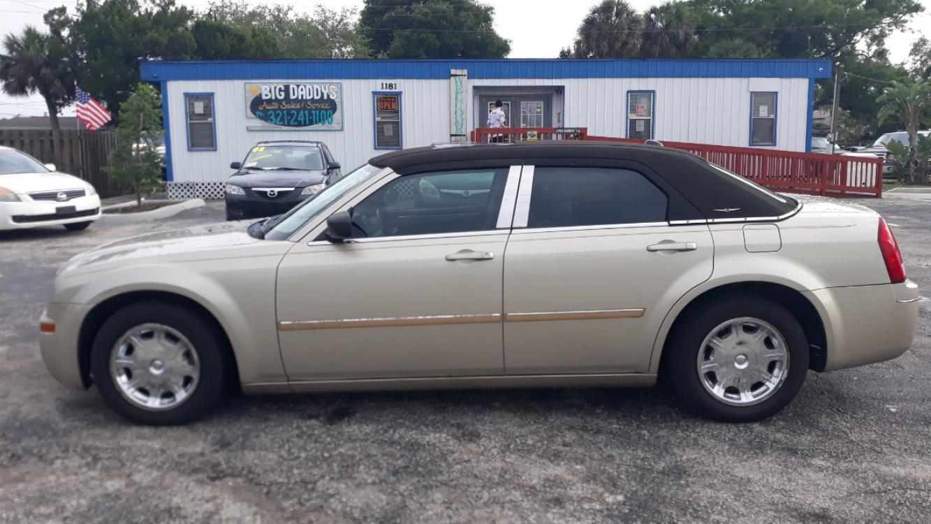 2006 Gold Chrysler 300 Touring (2C3LA53G96H) with an 3.5L V6 DOHC 24V engine, Automatic Overdrive transmission, located at 1181 Aurora Rd, Melbourne, FL, 32935, (321) 241-1100, 28.132914, -80.639175 - Photo #0